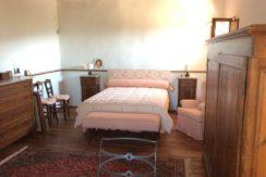 camera letto ex stalla piano terreno